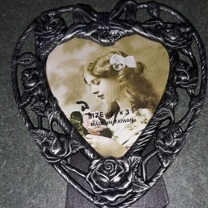 Pewter picture frame.